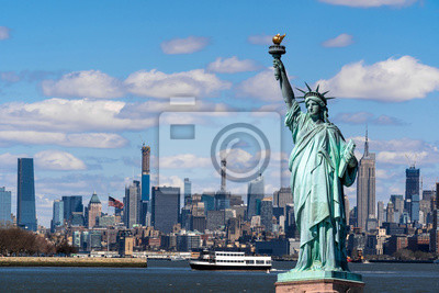 Plakat The Statue of Liberty over the Scene of New york cityscape river side which location is lower manhattan,Architecture and building with tourist concept