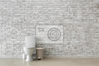 Plakat Toilet bowl near light brick wall
