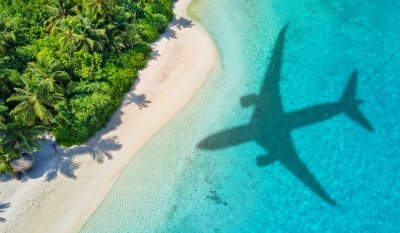 Plakat Travel concept with airplane shadow and beach