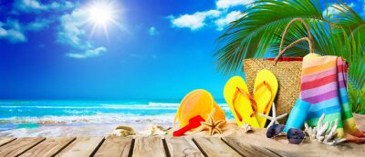 Plakat Tropical beach with sunbathing accessories, summer holiday background