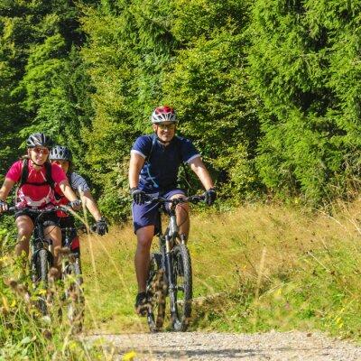 Plakat Trzy wesołe rowerzystów górskich