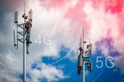 Plakat Two telecommunication towers with 4G, 5G transmitters. Cellular base stations with transmitting antennas on a telecommunication tower on a background of blue sky with pink-yellow clouds.