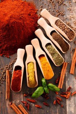 Plakat Variety of spices on kitchen table