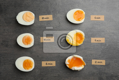 Plakat Various types of boiled eggs on grey background, flat lay. Cooking time