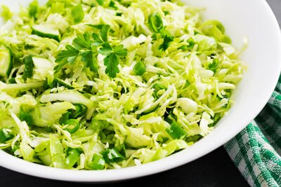 Vegetarian salad. Spring vegan salad with cabbage, cucumber, green onion and parsley.