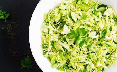 Vegetarian salad. Spring vegan salad with cabbage, cucumber, green onion and parsley. Top view, flat lay, overhead