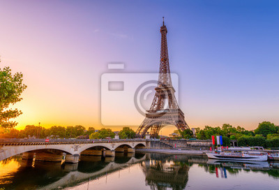 Plakat View of Eiffel Tower and river Seine at sunrise in Paris, France. Eiffel Tower is one of the most iconic landmarks of Paris
