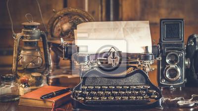 Plakat vintage photography still life with typewriter, folding camera,