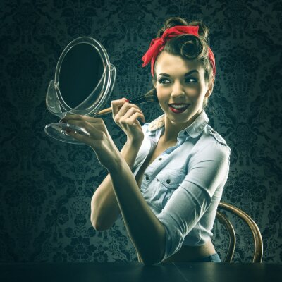 Plakat Vintage woman holding a mirror and makeup brush