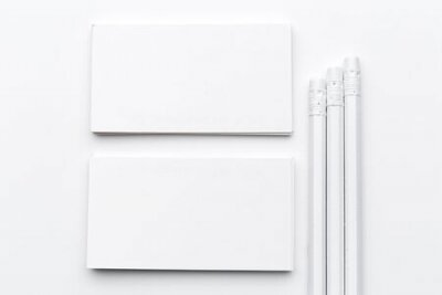 Plakat White blank business card. Office table desk with pencil. Top view and copy space for ad text. creative photo.