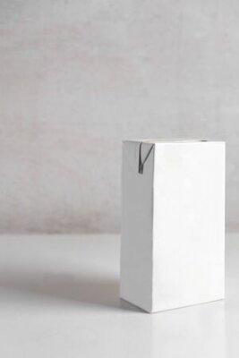 Plakat white box of milk on the table