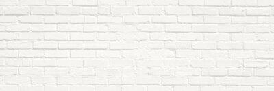 Plakat White brick wall background. Neutral texture of a flat brick wall close-up.