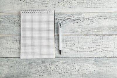 Plakat White paper Notepad and white pen on vintage shabby white wooden