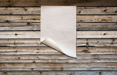 Plakat white paper on old wooden wall, background with copy space