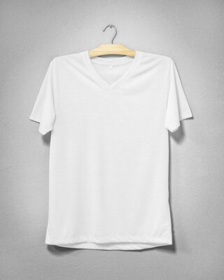 Plakat White shirt hanging on cement wall. Empty clothing for design. Front view.
