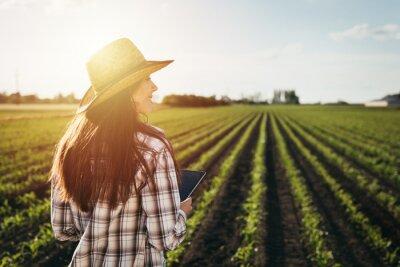 Plakat woman farmer walking outdoor