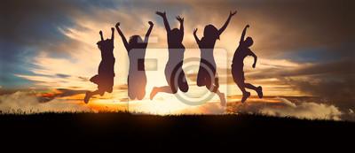 Plakat Woman jumping at sunset