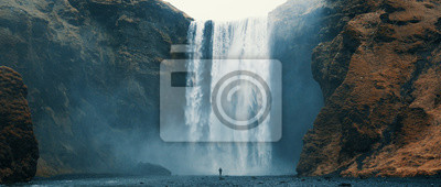 Plakat Woman overlooking waterfall at skogafoss, Iceland. Skógafoss, Ísland.