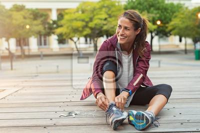 Plakat Woman wearing sport shoes