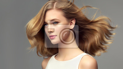 Plakat Woman with curly beautiful hair  on gray background. Girl with beauty a pleasant smile. Short wavy  hairstyle