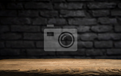 Plakat Wood table in front of rustic brick wall blur background with empty copy space on the table for product display mockup. Retro design montage presentation.