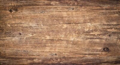 Plakat Wood texture background. Surface of old knotted wood with nature color, texture and pattern. Top view of weathered vintage wooden table with cracks. Brown rustic rough wood for backdrop.