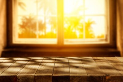 Wooden board of free space for your decoration and top cofer of shadows.Window space and blurred palms.