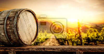 Plakat Wooden old retro barrel and autumn landscape with sunset time.
