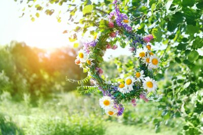 Plakat wreath of Meadow flowers in garden. beautiful summer season. Summer Solstice Day, Midsummer concept. floral traditional decor. pagan witch traditions, wiccan symbol and rituals