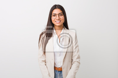 Plakat Young business arab woman isolated against a white background happy, smiling and cheerful.