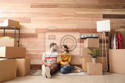 Plakat Young couple with belongings after moving into new house