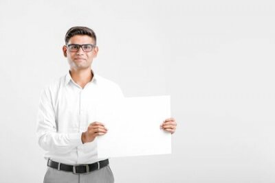Plakat Young Indian business executive showing blank sign board over white background