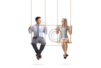 Plakat Young man and woman sitting on a swing and looking at eachother