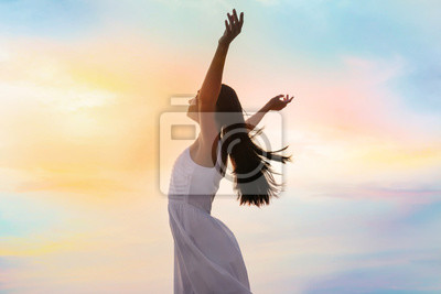 Plakat Young woman enjoying summer day against sky. Freedom of zen
