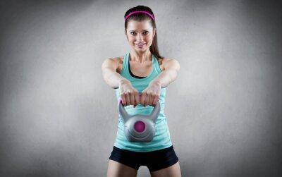 Plakat Young woman kettlebell workout