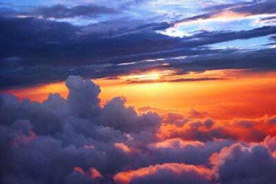 Plakat Zachód słońca nad chmurami
