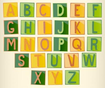 Plakat Zestaw zielonych i pomarańczowych wielkimi literami alfabetu na placu z ramą