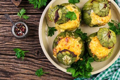 Zucchini stuffed with minced meat, cheese and green herbs. Baked in oven. Top view