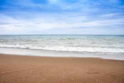A beautiful sea and sand with nice blue sky and cloud.