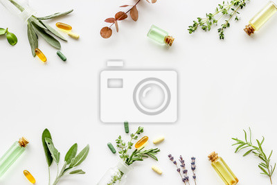 Tapeta Apothecary of natural wellness and self-care. Herbs and medicine on white background top view frame copy space