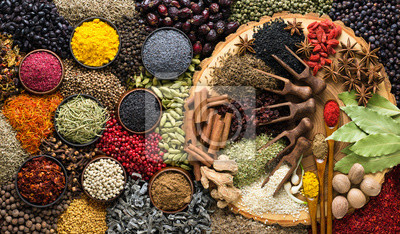 Tapeta Aromatic herbs and spices background. Seasoning as ingredient for delicious food.