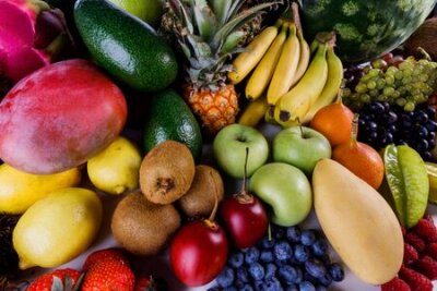 Tapeta Assorted background of many tropical colorful fruits harvest