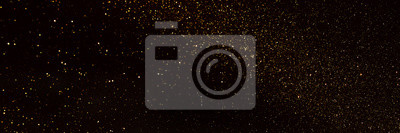 Tapeta background of abstract glitter lights. gold and black. de focused. banner
