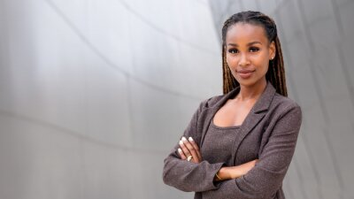 Tapeta Banner of African American female company leader CEO boss executive standing confident with ambition and pride, at financial