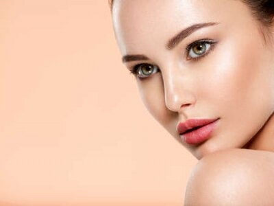 Tapeta Beautiful face of young woman with health fresh skin. Portrait of beautiful  brunette woman with clean face. Closeup face of young adult woman with clean fresh skin. Skin care.