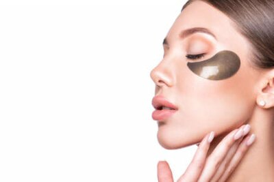 Tapeta Beautiful model woman with collagen and hydrogel eye patch.