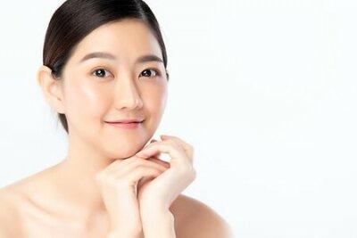 Tapeta Beautiful Young Asian Woman with Clean Fresh Skin. Face care, Facial treatment, Cosmetology, beauty and healthy skin and cosmetic concept .woman beauty skin isolated on white background.
