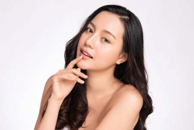 Tapeta Beautiful young asian woman with clean fresh skin on white background, Face care, Facial treatment, Cosmetology, beauty and spa, Asian women portrait