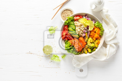 Tapeta Buddha bowl with grilled salmon fish, fresh cucumber, tomato, onion, sweet pepper, avocado, lettuce salad and rice, healthy balanced eating