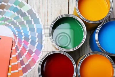 Tapeta Cans with paint and color palette on wooden background, top view